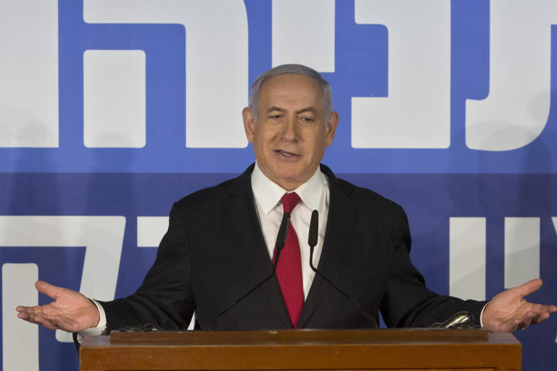 Israeli Prime Minister Benjamin Netanyahu gestures as he delivers a statement at the Prime Minister's residence in Jerusalem, Thursday, Feb. 28, 2019. Israel's attorney general on Thursday recommended indicting Prime Minister Benjamin Netanyahu with bribery and breach of trust in a series of corruption cases, a momentous move that shook up Israel's election campaign and could spell the end of the prime minister's illustrious political career. (AP Photo/Sebastian Scheiner)
