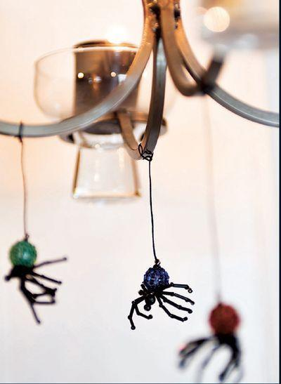 """<p>These pretty beaded spiders can be hung from just about anywhere. </p><p><strong><em><a href=""""https://www.womansday.com/home/decorating/a28912974/beaded-spiders/"""" rel=""""nofollow noopener"""" target=""""_blank"""" data-ylk=""""slk:Get the Beaded Spiders tutorial"""" class=""""link rapid-noclick-resp"""">Get the Beaded Spiders tutorial</a>. </em></strong></p><p><a class=""""link rapid-noclick-resp"""" href=""""https://www.amazon.com/Artistic-Wire-34-Gauge-Black-30-Yards/dp/B004CYFFE6?tag=syn-yahoo-20&ascsubtag=%5Bartid%7C10070.g.2488%5Bsrc%7Cyahoo-us"""" rel=""""nofollow noopener"""" target=""""_blank"""" data-ylk=""""slk:SHOP SPOOL OF WIRE"""">SHOP SPOOL OF WIRE</a></p>"""