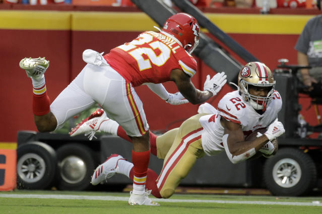 San Francisco 49ers running back Matt Breida (22) scores a touchdown against Kansas City Chiefs cornerback Juan Thornhill, left, during the first half of an NFL preseason football game in Kansas City, Mo., Saturday, Aug. 24, 2019. (AP Photo/Charlie Riedel)
