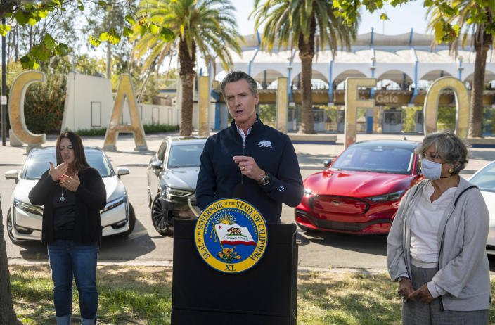 California Gov. Gavin Newsom speaks at a press conference on Wednesday, Sept. 23, 2020, at Cal Expo in Sacramento where he announced an executive order requiring the sale of all new passenger vehicles to be zero-emission by 2035, a move the governor says would achieve a significant reduction in greenhouse gas emissions. California would be the first state with such a rule, though Germany and France are among 15 other countries that have a similar requirement. (Daniel Kim/The Sacramento Bee via AP, Pool)