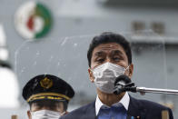 Japan's Defense Minister Nobuo Kishi, speaks to the members of the media after he inspected the British Royal Navy's HMS Queen Elizabeth aircraft carrier, back, at the U.S. naval base in Yokosuka, Kanagawa Prefecture, Japan Monday, Sept. 6, 2021. (Kiyoshi Ota/Pool Photo via AP)