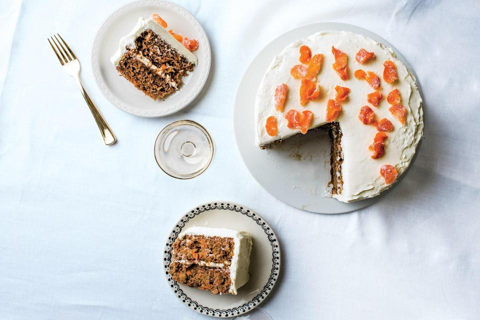 "Golden raisins, walnuts, dark rum, cinnamon, and ginger: This showstopping carrot cake has it all, including sugar-coated candied carrot coins for decoration. If Easter just doesn't feel complete to you without a carrot cake on the table, this is the recipe you need. <a href=""https://www.epicurious.com/recipes/food/views/best-carrot-cake?mbid=synd_yahoo_rss"" rel=""nofollow noopener"" target=""_blank"" data-ylk=""slk:See recipe."" class=""link rapid-noclick-resp"">See recipe.</a>"