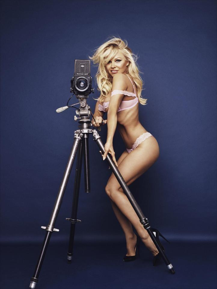 Pam poses with a tripod and camera wearing a pale-pink bra and underwear. Source: Rankin/ The Full Service