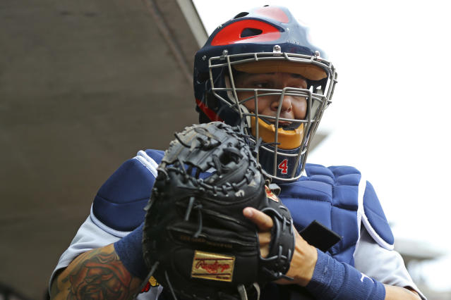 Yadier Molina experienced one of the most painful moments of his career on Saturday against the Cubs. (AP Photo)