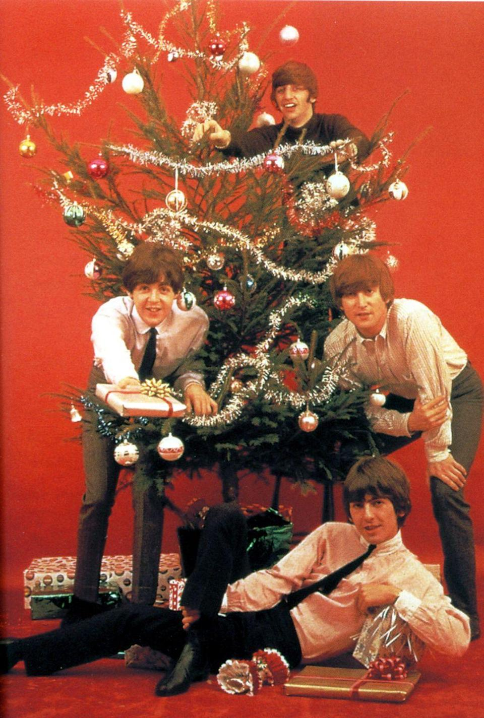 <p>The Beatles wished everyone a happy holiday as they posed for a Christmas shoot in 1964. The band stuck to their usual look for the photo, including grey slacks, white button-downs, and skinny black ties. </p>