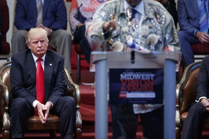 Donald Trump listens to Don King speak at campaign rally in Cleveland.