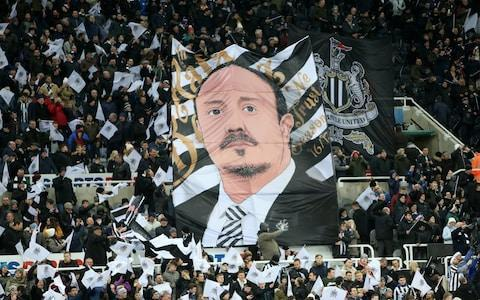 "This season has taken its toll on Rafael Benitez. The strain of a relegation haunted campaign is chiselled into his face, the emotion that comes with carrying the hopes of a football-centric city has weighed heavily on his shoulders, the stress of dealing with an owner like Mike Ashley has drained him of the enthusiasm he had when he first become Newcastle United manager. Yet, still the eyes sparkle when he talks about football, players and what needs to be done to improve. Benitez's mind is constantly buzzing with ideas and thoughts in the quest to return Newcastle to the upper reaches of the Premier League. The fire still burns. Football management was once described as a drug by one of his predecessors at St James' Park, Sir Bobby Robson. Benitez is an addict with no interest in booking into rehab. This is what he does, since he was just 13 years old, recording match details from his youth team on a Commodore 64 computer. Football has consumed him. It is a life he has endured, as well as enjoyed, for more than 40 years. ""I don't want to say that I am always working because it's 'Oh, Rafa is just football'…. I have my family,"" said Benitez, when asked, at the end of a training session during a warm weather training camp in Spain, if he is obsessed with his job. ""I sleep but at the same time, I feel the responsibility. Not just for the games and the performances of the first team, every decision. I go to the training ground early in the morning, between 7:30am and 8:30am. Not just me, my staff. Then, sometimes I leave at 8pm or 6pm. ""I have a big screen in my office to watch games and I prefer that, because if I go home, I only have the computer and that's quite small. ""I don't only watch football, I like films. But I am [also] on the computer [watching football], you can see someone punching someone or jumping over things, or whatever, in the background, you can concentrate on both things. ""It is easier now, at the start of my career, I only had VHS tapes. I would have two screens, two remote controls in my hand and I would watch both at the same time."" This is Benitez - a man who claims he likes watching films, but only does so while he has some sort of football on at the same time. Speaking to the former Liverpool, Chelsea, Real Madrid, Napoli and Inter Milan manager at the team's isolated hotel, a short drive from Spain's south coast tourist resorts, Benitez is in high spirits, the 3-0 win over Southampton the previous weekend, lifting Newcastle five places clear of the relegation zone. But all is not serene. The 57-year-old loves this job, the club and the city. He enjoys the sort of adulation not seen on Tyneside since Robson was in charge 15 years ago, but he has found working for a man like Ashley difficult to say the least. Rafa Benitez has enjoyed the support of Newcastle fans Credit: GETTY IMAGES Yet, still he stays, offering hope of harmony where once there was only discord and for all of the political and economic distractions that come with working for Ashley, the Spaniard remains happiest on the training ground. ""The winning teams sometimes have one special player who can make a difference,"" Benitez explains. ""Some of the [best]teams are teams. We are a team. ""We don't have one player who can win three games in a row, like Messi or whatever. What we have is a team that know each other really well, who know the jobs they have to do, and they try to do this job in the best way possible. ""It does make me proud to see players like Jamaal Lascelles and Paul Dummett, and you see they are improving. But that is because they learn. I have been doing this for a long time and it is the players who learn who you need to work with. ""You have to coach them to think and understand the game. If they cannot, then you have to tell them 'you have to do this anyway,' but the best thing to do is say 'listen, if he is doing this, then maybe you have to do that.' Benitez cuts an animated figure on the touchline at Newcastle Credit: GETTY IMAGES ""After you go and watch the video, I'm asking them sometimes, 'what do you see here?' This is how they improve. It takes time. It's not something which you will see in one month and that's it. ""I was a PE teacher and when you teach, you can say 'you have to do this.' It's an order. That's one way. ""Or you can say, 'listen, we have these problems, so give me the solution' and they have to think about it. Or you can say, 'here are three options - which one is best?' And he has to choose one. ""It might depend on the player. If the player is very clever, he will think about the problem and come up with a solution. Sometimes you can let him make a mistake. Then they go back and realise we have to do this. The main thing is that they have to think. If they think, they learn. ""It's what I try to do because I'm 100 per cent convinced that they will improve if they think. It's not just about following orders."" It is these people skills that make Benitez special and it is those human qualities that filter into everything he does. Like most modern managers, Benitez draws heavily on statistical data, but just as it is the sound of a player kicking a ball that tells him whether their technique is sound, it is not numbers on a screen that tell him whether he wants to sign a player or not. My favourite ever Premier League player ""When I was 13 years old I used to keep notes on all my teammates,"" Benitez adds. ""I still have the books. ""At 13, I went to Real Madrid and started taking notes. I was giving points and marks to our players after every game, writing down the top scorers. I still have everything. When I was 16, I was coach in the summer and a player. When I was at university at 17, 18, I was player, coach, manager. ""I used to put all the training sessions on to a computer, a Commodore 64, I didn't play games on it, I put information on there. It was very basic, but at this time I was using computers when nobody was using computers. ""What I learned is that you have to be careful with computers. They give too much information. You need to be sure you have the right information and at the same time, one thing I don't want to do - and it's a key thing - is lose the feeling. ""I know how you feel when you make a mistake. Like a lot of professionals, I can hear when you are kicking the ball properly or not (he smacks his hands together), just by the sound. Benitez delivers instructions to Ayoze Perez Credit: AFP ""I like to see players. We see the players and know if they are good or bad. You can't say I don't want the information, you need the data, but there is more. ""When I joined Newcastle, I asked for all the data about players in the Championship, so I have the best stats in the Championships and I was watching players and talking to people and saying 'what do you know about this player'. That human part is crucial. ""You can watch a player and have a feeling and after you can see the stats. That is fine, but it's not just the stats. You have to watch the players."" Benitez currently has around 500 potential transfer targets on a computer and will try to watch them all over the coming weeks and months. The question is, though, will he be allowed to sign any of them in the summer. Newcastle have a manager who only wants the best for the team, but they have an owner who does not seem to understand why that matters. The relationship between the two most powerful men at St James' Park remains strained and until is it is healed, Benitez's future will remain a cause for concern."