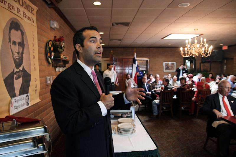 George P. Bush makes a campaign stop in El Paso, Texas, on Monday, March 3, 2014. In the nation's first primary of the season, Texas politicians scramble to fill a void left by an extraordinary shakeup in state offices. Bush, the nephew of one former president, grandson of another and son of an ex-Florida governor is expected to officially join the family business of winning elections when he secures the Republican land commissioner nomination during Tuesday's Texas primary. (AP Photo/ Juan Carlos Llorca)