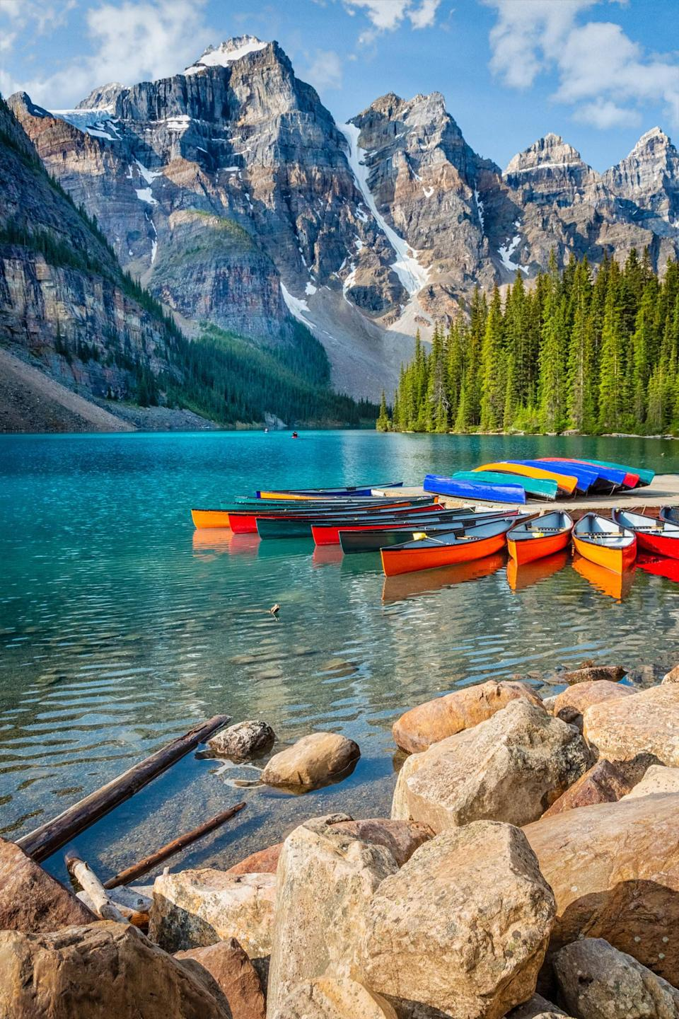 Moraine Lake with Colorful Canoes Banff National Park Canada.