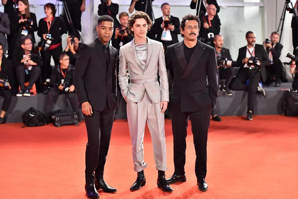 Timothée Chalamet (middle) in a Haider Ackermann suit at the Venice film festival