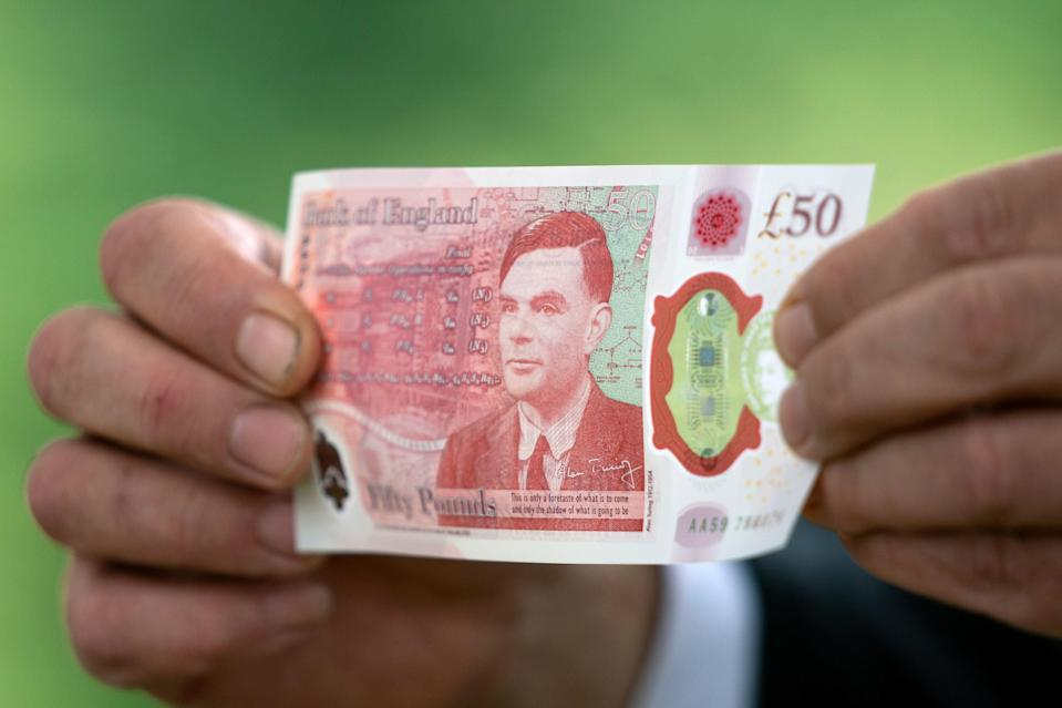 Bank of England Governor Andrew Bailey holds the new £50 note (REUTERS)