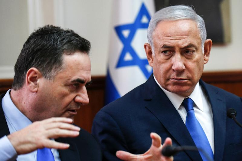 Israeli Prime Minister Benjamin Netanyahu (R) is handing the role of foreign minister to his right-wing rival from inside the Likud party Israel Katz (L)
