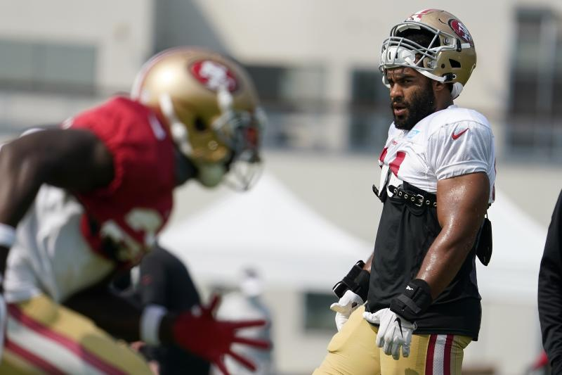 The NFL will have its eye on the 49ers putting Fred Warner (right) on the COVID-19 reserve list. (Tony Avelar/San Francisco Chronicle via AP, Pool)