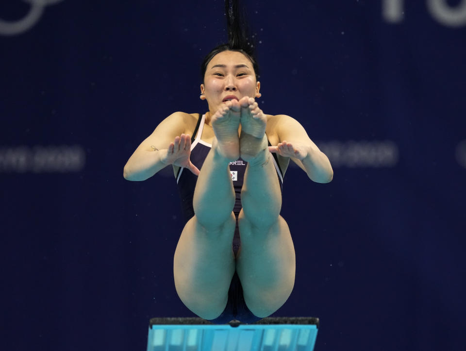 Suji Kim of Korea competes in women's diving 3m springboard preliminary at the Tokyo Aquatics Centre at the 2020 Summer Olympics, Friday, July 30, 2021, in Tokyo, Japan. (AP Photo/Dmitri Lovetsky)
