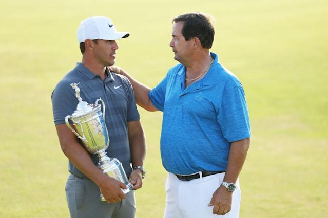 Bob Koepka, right, congratulates his son Brooks after winning back-to-back U.S. Opens. (Getty)