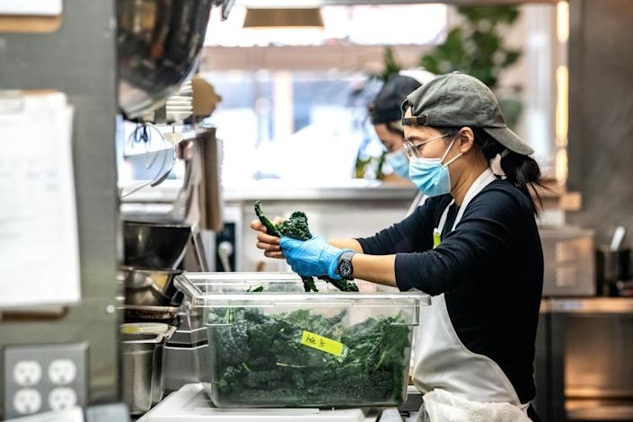 Elaine Chang and Steven Park work inside the kitchen at Yang's Kitchen.