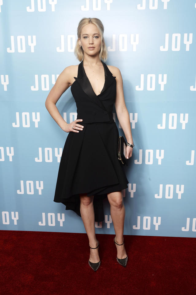 <p>Oh the perks of being a Dior girl! For the London premiere of her latest movie, Lawrence wore a custom Dior bespoke two-piece tuxedo dress made of satin with a high-low skirt and a plunged neckline. Her makeup, per usual, was au natural. (Photo: Getty Images) </p>