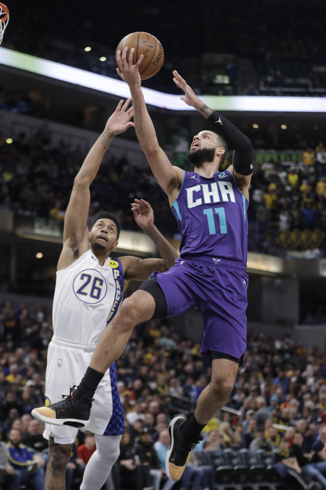 Charlotte Hornets' Cody Martin (11) shoots against Indiana Pacers' Jeremy Lamb (26) during the first half of an NBA basketball game, Sunday, Dec. 15, 2019, in Indianapolis. (AP Photo/Darron Cummings)