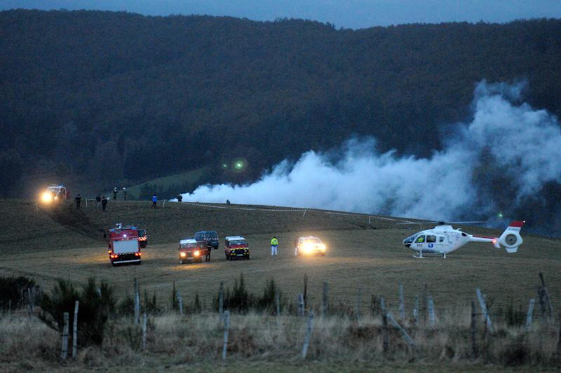 Police, firemen and a medical helicopter near the Algerian military cargo plane crash scene, in Trelans, southern France, Friday, Nov. 9, 2012. The plane went down with six people aboard, according to local police. The military cargo plane had taken off from Paris and was returning to Algeria. (AP Photo/Eva Koord) FRANCE OUT