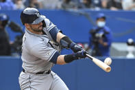 Tampa Bay Rays' Mike Zunino hits a solo home run during the fourth inning of a baseball game against the Toronto Blue Jays, Wednesday, Sept. 15, 2021 in Toronto. (Jon Blacker/The Canadian Press via AP)