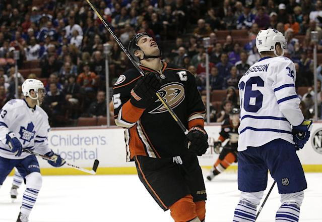 Anaheim Ducks' Ryan Getzlaf, center, reacts after missing a shot during the second period of an NHL hockey game against the Toronto Maple Leafs on Monday, March 10, 2014, in Anaheim, Calif. (AP Photo/Jae C. Hong)