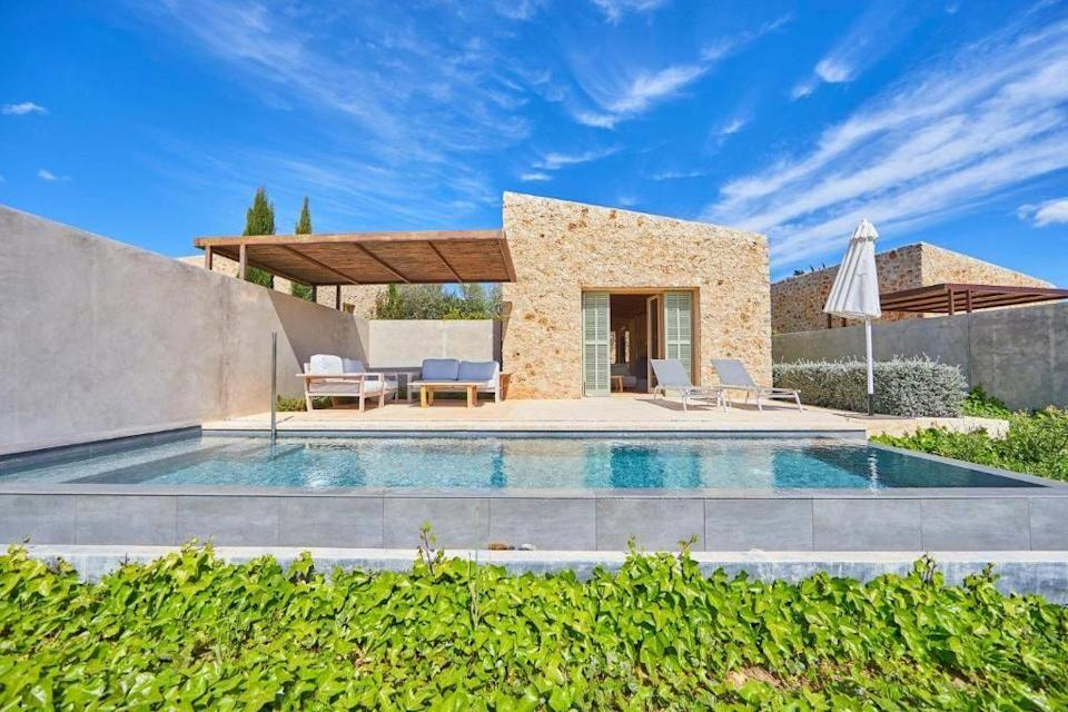"""<p>Set on an estate of over 200 square metres of rolling countryside with ancient olive groves, almond andcarob trees, <a href=""""https://go.redirectingat.com?id=127X1599956&url=https%3A%2F%2Fwww.booking.com%2Fhotel%2Fes%2Fson-penya-petit.en-gb.html%3Faid%3D2070929%26label%3Dmallorca-hotels&sref=https%3A%2F%2Fwww.redonline.co.uk%2Ftravel%2Fg37570714%2Fmallorca-hotels%2F"""" rel=""""nofollow noopener"""" target=""""_blank"""" data-ylk=""""slk:Son Penya"""" class=""""link rapid-noclick-resp"""">Son Penya</a> is just a short drive from the island's northeast coast. The adults-only hotel is a former finca, with some parts dating back to the early 1900s. Now a stylishly rustic retreat, there are 20 rooms and suites, eight of which have their own private pools.</p><p>The hotel harvests its own almonds and produces olive oil, which it uses in its own restaurant 5'S. The restaurant menu is based on a fusion of international cuisine with locally produced wines by Toni Gelabert (complimentary wine tastings are available every week). For relaxation, the spa has a heated indoor pool, a Swedish sauna and fully equipped gym overlooking the countryside, while complimentary yoga sessions are held every week.</p><p><a class=""""link rapid-noclick-resp"""" href=""""https://go.redirectingat.com?id=127X1599956&url=https%3A%2F%2Fwww.booking.com%2Fhotel%2Fes%2Fson-penya-petit.en-gb.html%3Faid%3D2070929%26label%3Dmallorca-hotels&sref=https%3A%2F%2Fwww.redonline.co.uk%2Ftravel%2Fg37570714%2Fmallorca-hotels%2F"""" rel=""""nofollow noopener"""" target=""""_blank"""" data-ylk=""""slk:CHECK AVAILABILITY"""">CHECK AVAILABILITY</a></p>"""