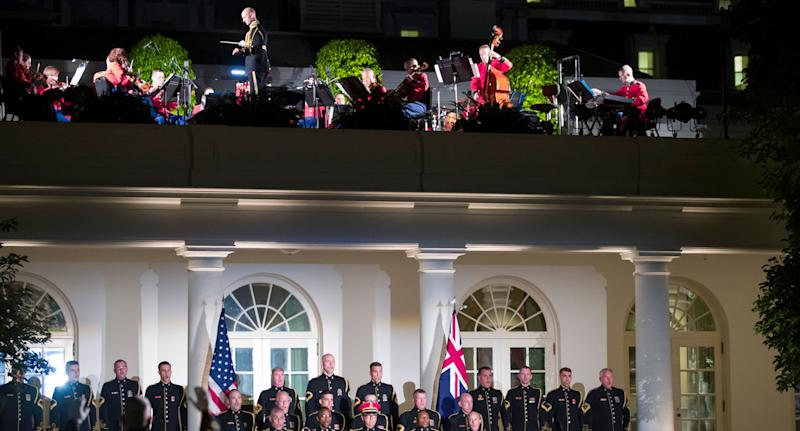 Guests listen to music in the Rose Garden of the White House during a State Dinner with President Donald Trump and first lady Melania Trump. Source: AAP
