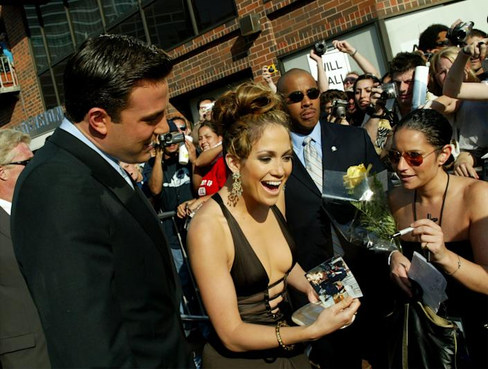"""Ben Affleck and Jennifer Lopez greeting fans at the premiere of """"Gigli."""""""