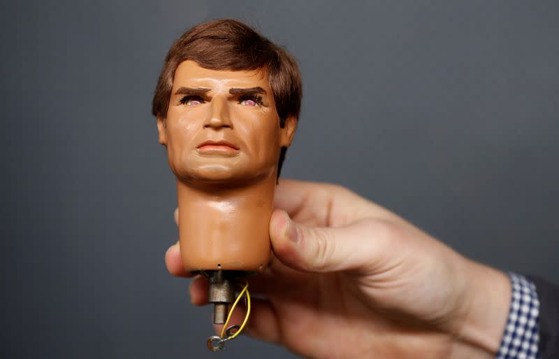 An original Captain Ochre puppet head from the Captain Scarlet tv series, by Gerry Anderson, is held by a worker at Ewbank's Auctioneers, ahead of an upcoming sale, in Woking