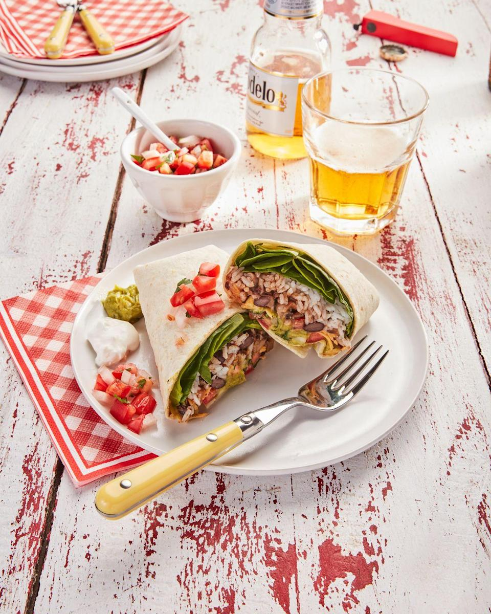 """<p>Hearty, healthy, and super easy to make, these fast burritos make a great dinner, or an excellent next-day lunch!</p><p><strong><a href=""""https://www.countryliving.com/food-drinks/a36343644/veggie-and-bean-burritos-recipe/"""" rel=""""nofollow noopener"""" target=""""_blank"""" data-ylk=""""slk:Get the recipe"""" class=""""link rapid-noclick-resp"""">Get the recipe</a>.</strong></p>"""