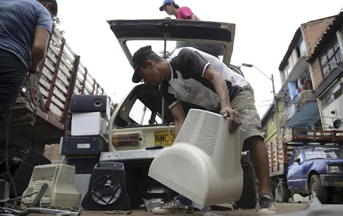 As well as old-generation phones and laptops, areas of e-waste are growing as society becomes increasingly electrified (AFP Photo/RAUL ARBOLEDA)