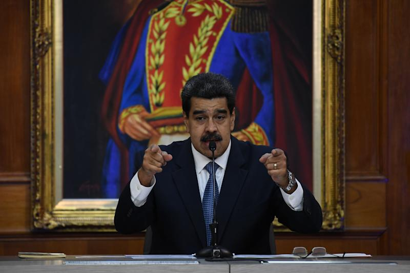 Venezuelan President Nicolas Maduro gestures as he speaks during the Simon Bolivar national journalism award ceremony at Miraflores presidential palace in Caracas on June 27, 2019. (Photo by Yuri CORTEZ / AFP) (Photo credit should read YURI CORTEZ/AFP/Getty Images)