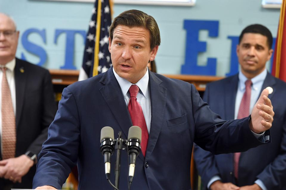 Gov. Ron DeSantis speaks during a press conference at Destin Elementary School  Wednesday where he announced that Florida's teachers would be receiving a $1,000 bonus.
