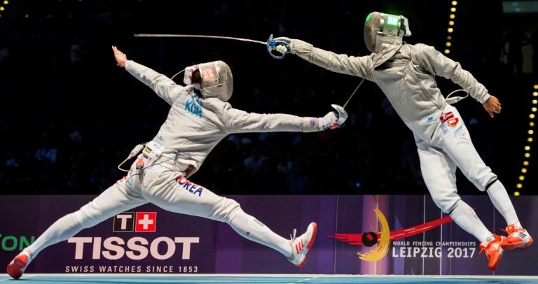 South Korea's Sanguk Oh (L) and Hungarian Aron Szilagyi vie during the team men's sabre final between South Korea and Hungary at the World Fencing Championships in Leipzig, Germany (AFP Photo/ROBERT MICHAEL)