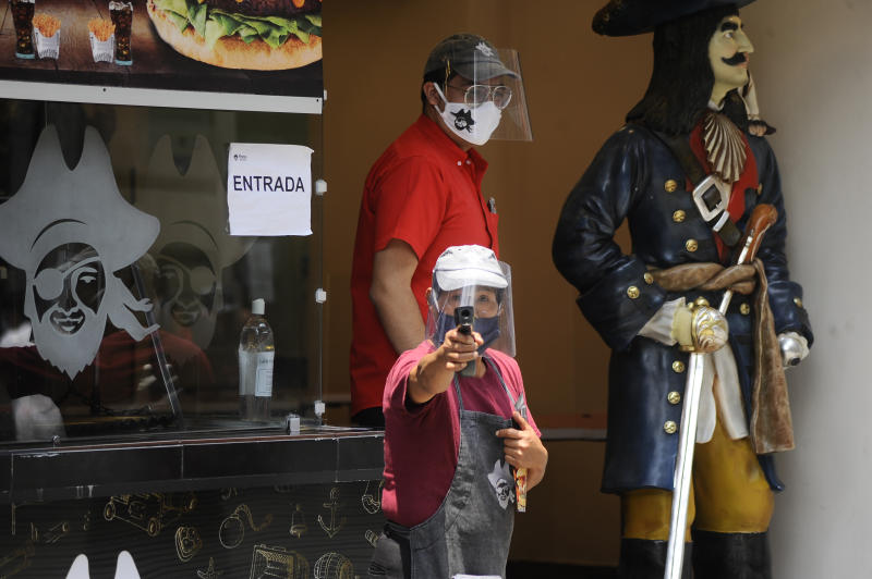 MEXICO CITY, MEXICO - JUNE 30, 2020: A vendor checks temperature in downtown Mexico City; amid the new coronavirus pandemic has started to ease the COVID-19 lockdown restrictions to restart the economy, after several months of lockdown measures imposed in a bid to slow down the spread of the ongoing pandemic.. On June 30, 2020 In Mexico City, Mexico- PHOTOGRAPH BY Ricardo Castelan Cruz / Eyepix Group / Barcroft Studios / Future Publishing (Photo credit should read Ricardo Castelan Cruz / Eyepix Group/Barcroft Media via Getty Images)