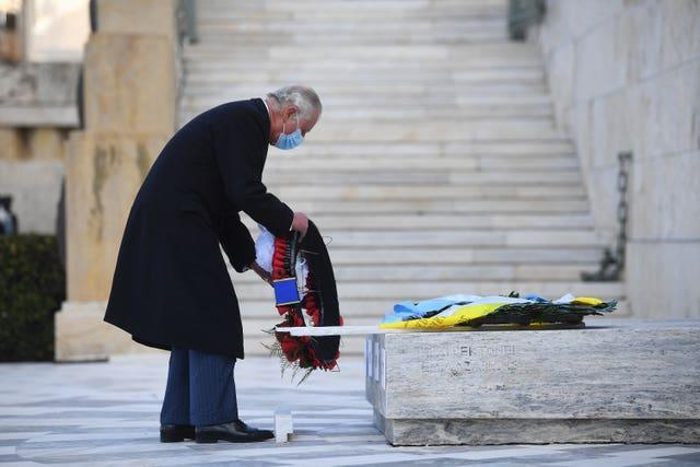 The Prince of Wales lays a wreath at the Memorial of the Unknown Soldier in Syntagma Square, Athens