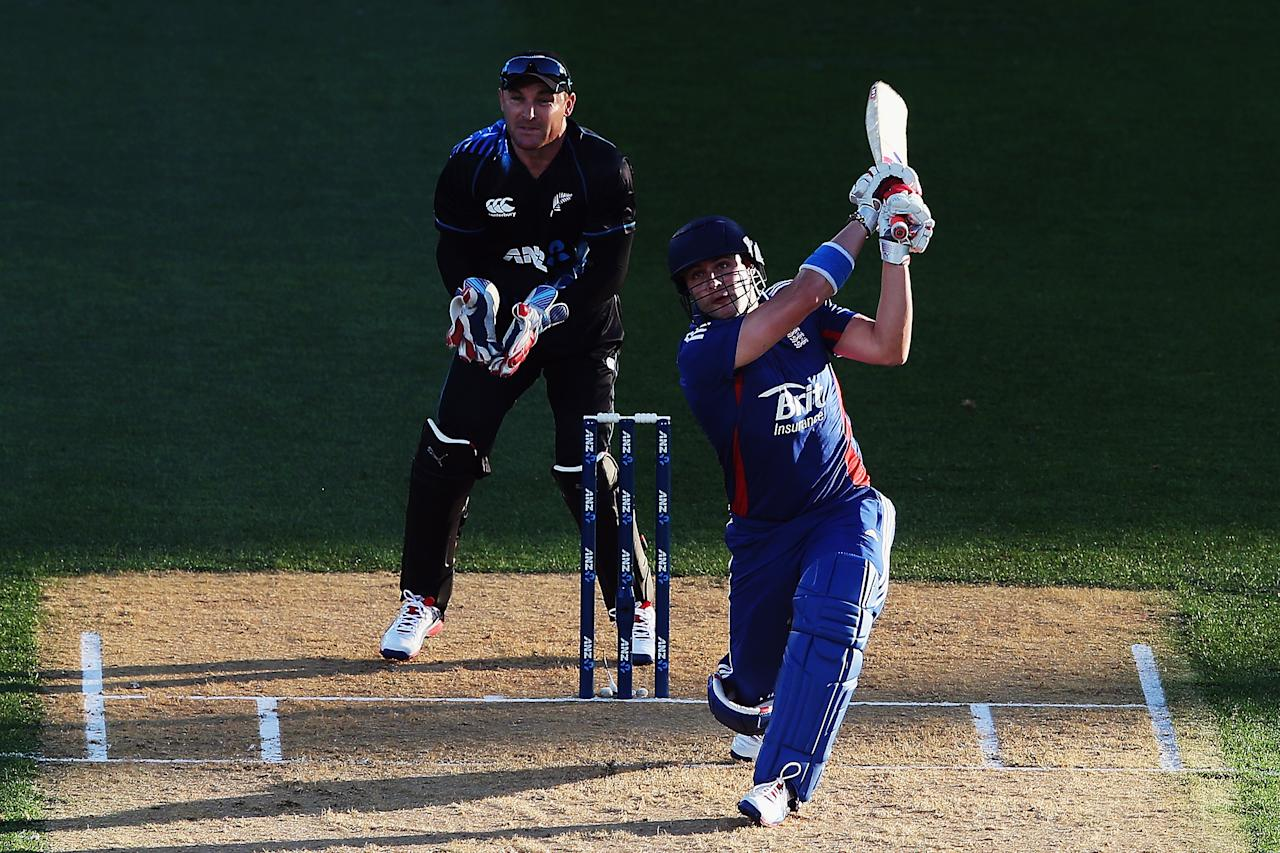 AUCKLAND, NEW ZEALAND - FEBRUARY 09: Luke Wright of England hits the ball away fro six runs during the 1st T20 International between New Zealand and England at Eden Park on February 9, 2013 in Auckland, New Zealand.  (Photo by Hannah Johnston/Getty Images)