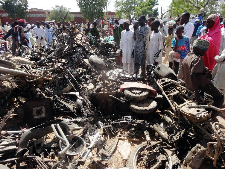 Burnt motorcycles outside the central mosque in Kano on Novemer 29, 2014, a day after twin suicide blasts hit the mosque, killing at least 120 people (AFP Photo/Aminu Abubakar)