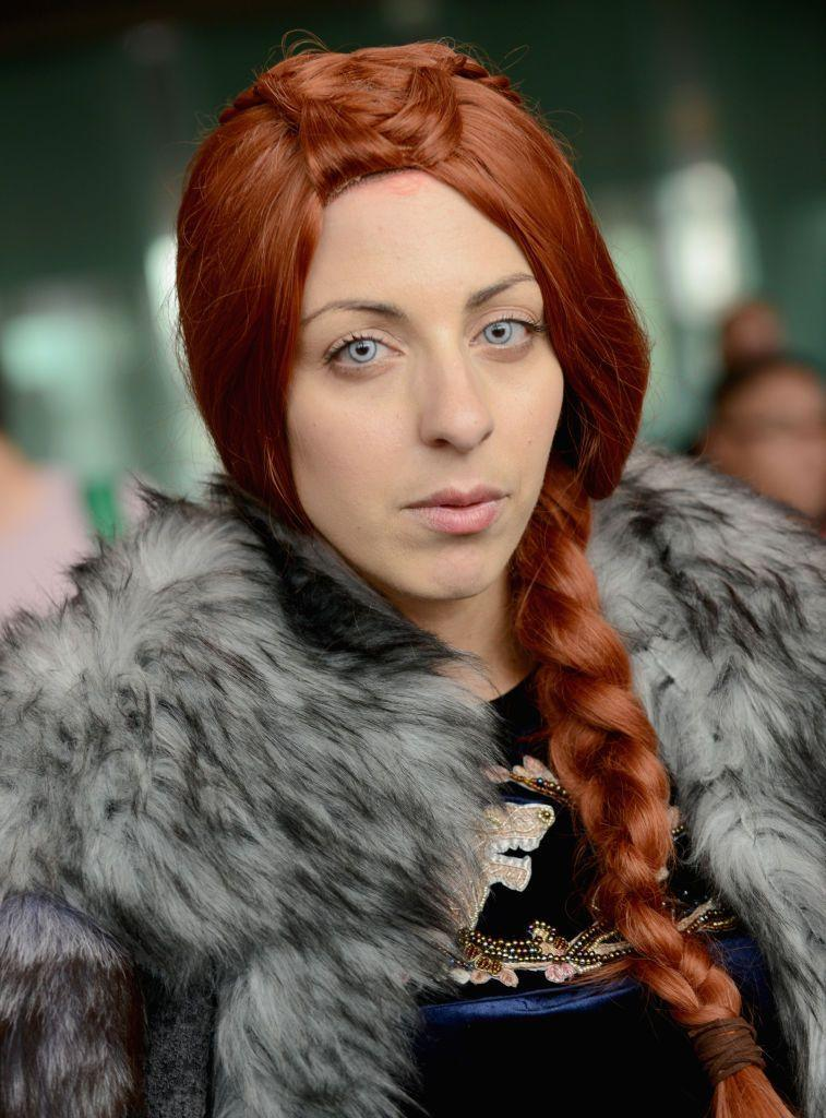 """<p>Sansa probably had the widest range of looks throughout the series, going from her bright flowy dresses in King's Landing to her darker looks in Winterfell. Any of her looks, and accompanying braided hairstyles, will make for a stunning costume.</p><p><a class=""""link rapid-noclick-resp"""" href=""""https://www.amazon.com/Yilys-Womens-Halloween-Cosplay-Fluffy/dp/B07H7M4R8C?tag=syn-yahoo-20&ascsubtag=%5Bartid%7C10070.g.28762544%5Bsrc%7Cyahoo-us"""" rel=""""nofollow noopener"""" target=""""_blank"""" data-ylk=""""slk:SHOP RED WIG"""">SHOP RED WIG</a></p>"""