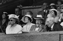<p>Queen Mary, sporting some iconic shades, watches the play alongside her husband, King George V.</p>