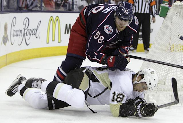 Columbus Blue Jackets' David Savard, top, knocks Pittsburgh Penguins' Brandon Sutter to the ice during the first period of Game 6 of a first-round NHL playoff hockey series Monday, April 28, 2014, in Columbus, Ohio. (AP Photo/Jay LaPrete)