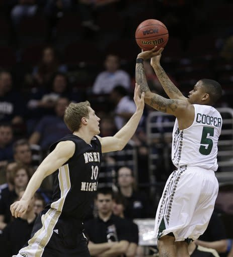 Ohio's D.J. Cooper, right, shoots over Western Michigan's Brandon Pokley during the first half of an NCAA college basketball game in the semifinals of the Mid-American Conference tournament Friday, March 15, 2013, in Cleveland. (AP Photo/Tony Dejak)