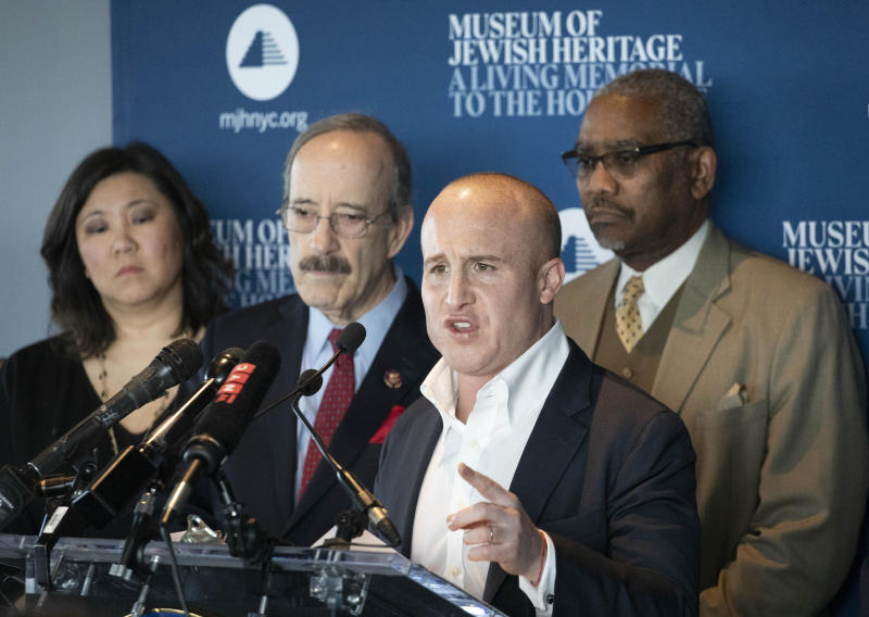 U.S. Rep. Max Rose, D-N.Y., speaks at the Museum of Jewish Heritage on Jan. 2, 2020, in New York. Behind him, from left, are fellow Democratic Reps. Grace Meng, Eliot Engel and Gregory Meeks. The New York politicians said that as part of legislation passed last month, Congress increased funding for the Nonprofit Security Grant Program to $90 million, a 50 percent increase from previous funding levels. The grants will help improve security at such institutions as synagogues, mosques, churches and community centers. (Mark Lennihan/AP)