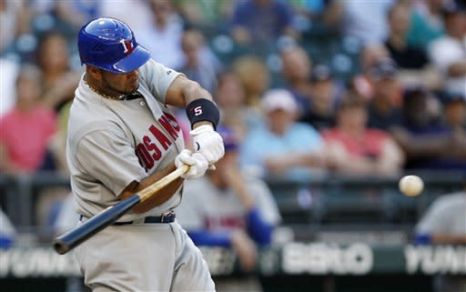 Los Angeles Angels' Albert Pujols doubles against the Seattle Mariners in the fifth inning of a baseball game, Saturday, May 26, 2012, in Seattle. (AP Photo/Elaine Thompson)