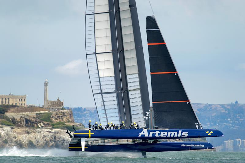 Sweden's Artemis Racing passes Alcatraz Island while racing Italy's Luna Rossa Challenge in a Louis Vuitton Cup semi-finals match on August 6, 2013, in San Francisco
