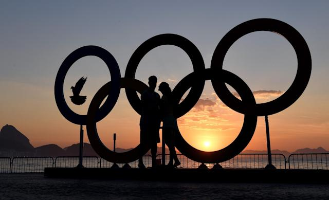 <p>The Olympics Rings at sun rise on Copabana Beach on August 6, 2016 in Rio de Janeiro, Brazil. (Photo by Shaun Botterill/Getty Images) </p>