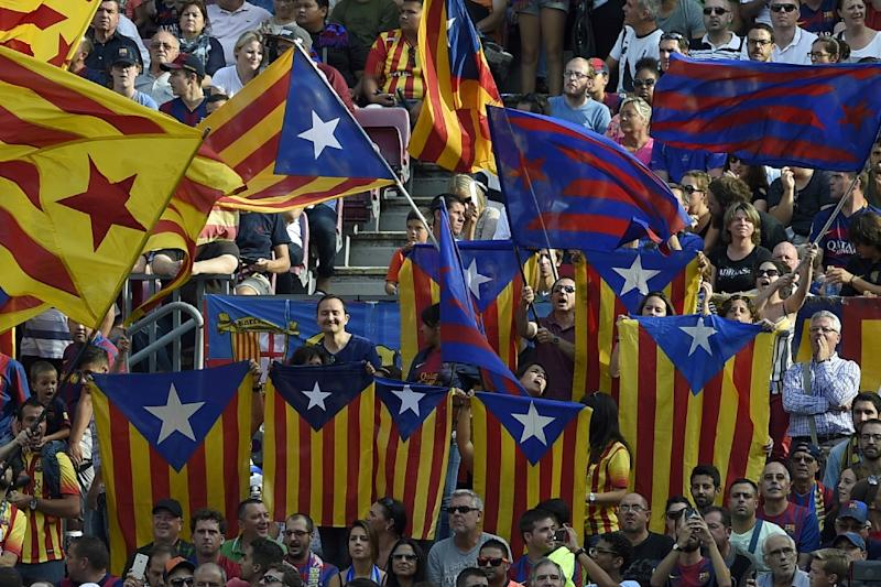 """Barcelona's supporters wave """"Esteladas"""" (Catalan pro independence flags) during the Spanish league football match FC Barcelona v UD Las Palmas at the Camp Nou stadium in Barcelona on September 26, 2015 (AFP Photo/Lluis Gene)"""