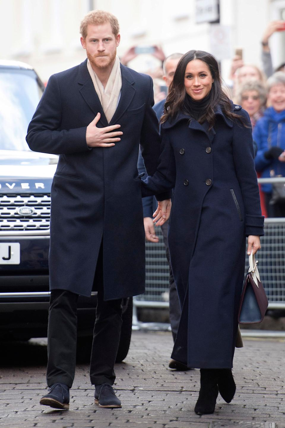 This one time in November 2017, Prince Harry and Meghan Markle wore matching dark overcoats, and now we want someone to wear matching overcoats with.