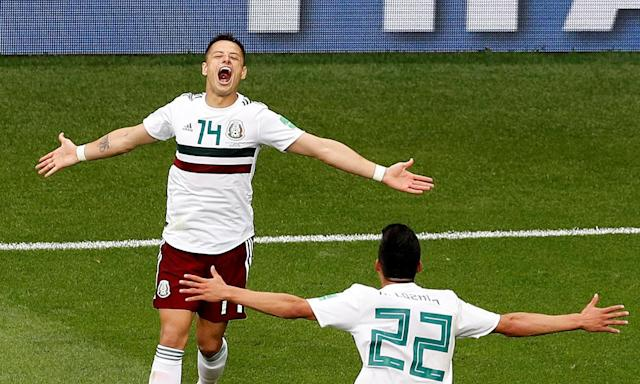 Javier Hernandez celebrates with Hirving Lozano after putting Mexico 2-0 up against South Korea.
