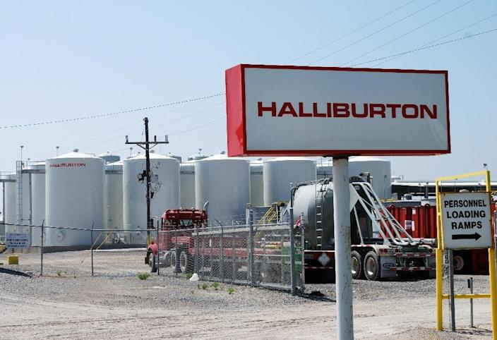 Halliburton will pay nearly $30 million in fines and other fees to resolve a bribery case involving Angola's state oil company (AFP Photo/MIRA OBERMAN)
